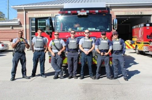 Firefighters with bullet proof vests