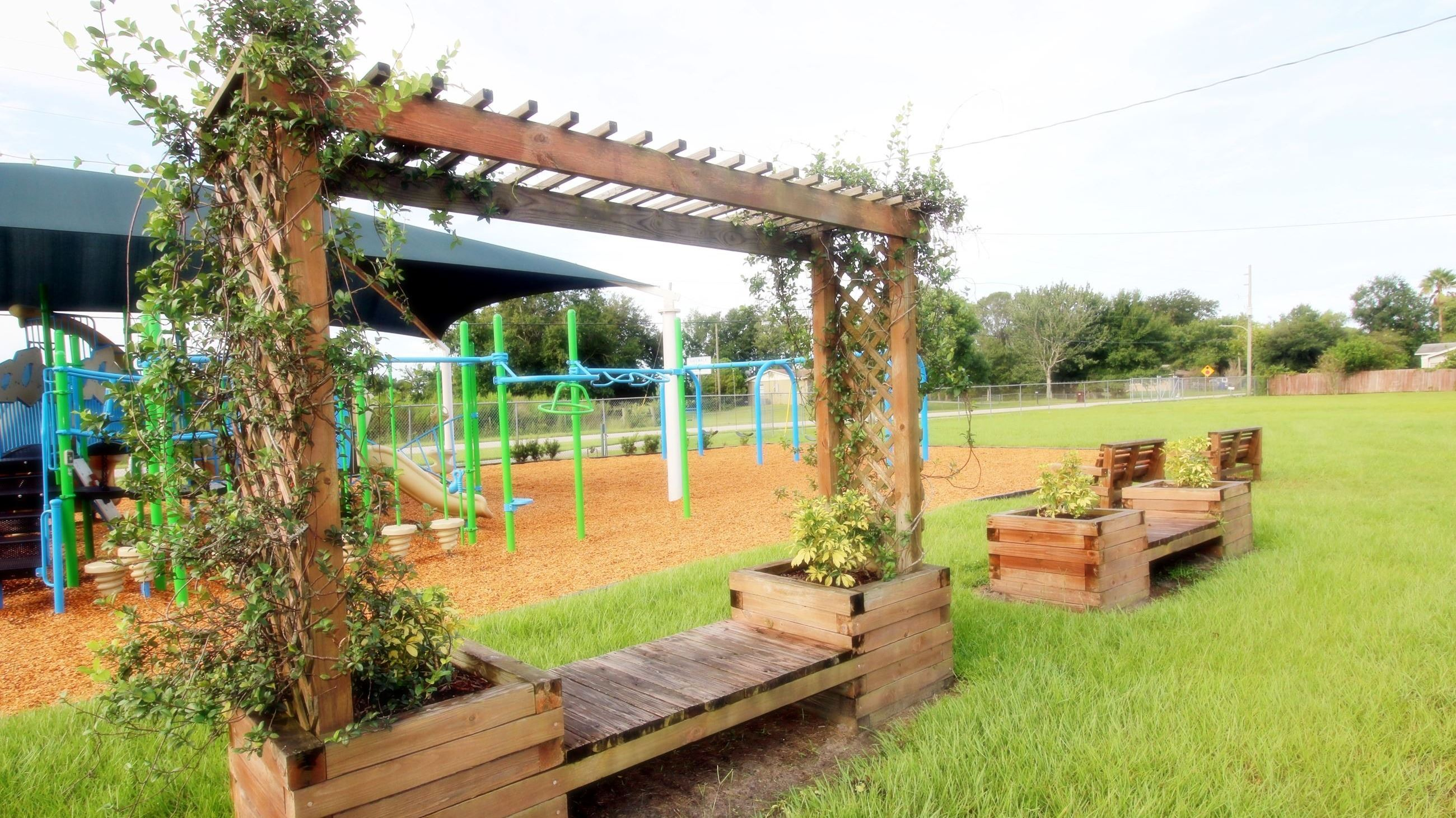 ARBOR BENCH WITH AT PLAYGROUND AT HOPKINS PARK  PHOTO